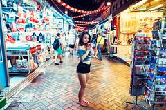 Chinatown Touring (Jon Siegel) Tags: nikon d810 sigma 24mm 14 sigma24mmf14art woman girl chinatown chinese cute asia singapore singaporean people giftshops lanterns glow ambience motion tourists touring night evening street sexy beauty beautiful fashion style fashionable modeling model