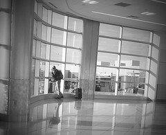300/366 My Favorite Spot to Wait (Bernie Anderson) Tags: ifttt 500px indoors window room airport reflection furniture lobby people architecture monochrome adult business glass floor street photography black white man ceiling