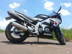 Anita's presence :) (Rodrigo Alceu Dispor) Tags: blue sky white green grass bike clouds suzuki anita speedy crawling motoca fillisbinna