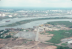 """Aerial view of Staten Island, Pralls Island and Arthur Kill with """"New Jersey"""" in distance 1985 (NYCEDC) Tags: statenisland arthurkill nycwaterfront nycedc prallsisland newyorkcitywaterfront edcportstransportation"""