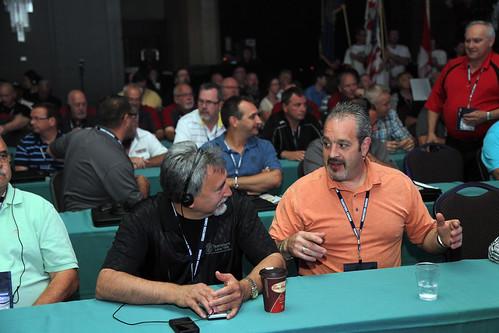 Males Conversing During Conference / Conversation d'hommes lors d'une conférence