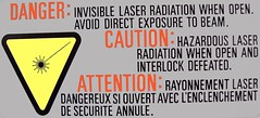Caution: Hazardous Laser Radiation! (JPC24M) Tags: danger beam laserbeam rayon attention pictogram pictogramme faisceau lecteurcd rayonlumineux faisceaulaser cddriver