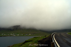 Nes Hvalba, Faroe Islands (JPE Photos) Tags: road fog nes hvalba faroeislands faroe faroes suuroy sea waves mountain houses town lovely beauty green blue white