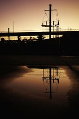 Electric sunset. 200/366 (jenniferdudley) Tags: sunset reflection electric reflections puddle power sunsets sonyalpha day200366 sonyphotography sonya7 366the2016edition 3662016 18jul16