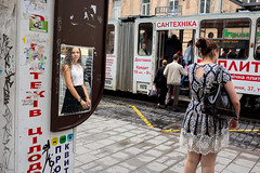 . (www.piotrowskipawel.pl) Tags: streetphotography street city lvivoblast lviv ukraine documentary documentaryphotography streetscene busstop tram transport publictransport stop girl woman mirror reflections reflection passengers pawepiotrowski piotrowskipawelpl