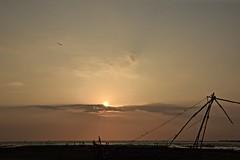 Whispers From Kochi (The Spirit of the World) Tags: kochi cochin india kerala sun light sunset dusk net fishingnet chinesefishingnet sea arabiansea seascape nature sky clouds