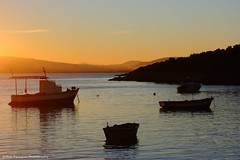 Like the summer... (explore #17 ) (Nick Panagou) Tags: light sunset sea sky orange sun water contrast landscape boats greece thessaly orangeskies silhouettesshadows