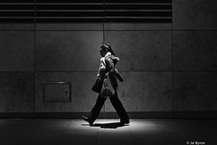 Walkin' (kungfuslippers) Tags: blackandwhite night zeiss walking manchester mono sony a7 sonnar ilce7