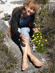 Wish you were here (Time-Freeze) Tags: flowers mountain nature rocks bodylanguage capetown tablemountain womanbarefoot windandlonghair
