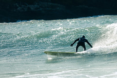 Manorbier   Surfer III (_nod) Tags: uk sea beach wales coast seaside surf surfer pembrokeshire manorbier