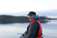 Papa on a canoe (Camusi) Tags: trees friends portrait lake canada reflection water souvenirs mirror boat dock cabin eau north cottage lac nwt calm arbres papa chalet northwestterritories miroir amis reflexion tno nord calme yellowknife sapins northof60 cottagelife riverlake adayatthecabin