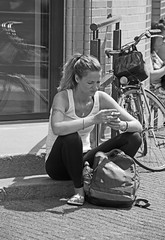Scroll and puff (Dutch_Chewbacca) Tags: world life street girls summer people urban blackandwhite bw woman white black holland art netherlands girl monochrome beauty dutch tattoo canon de women warm europa europe pretty day kei sitting slim weekend candid nederland citylife streetphotography july saturday sigma sunny streetlife eindhoven sit streetphoto ponytail unposed 9th seated zwart wit brabant sneaky fit noordbrabant urbanlife obsessed dlsr 2016 040 straatfotografie 550d gekste unpolished