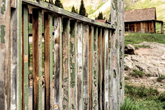Porch Rail (Scosanf) Tags: colorado coloradotrails outdoor historical ghosttown mining decay abandoned forgotten faded weathered paint dof bokeh lines travel trip vacation summer mountains rockymountains sanjuanmountains canon eos 6d ef2470mmf28lusm topazlabs