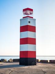Bike on the Pier (GijsPeijs) Tags: pier bike red white lighthouse sea