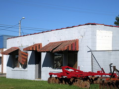 Damaged Awning And Farm Equipment. (dccradio) Tags: lumberton nc northcarolina robesoncounty stormdamage hurricane hurricanematthew matthew aftermath weatherrelated storm damage ag agriculture agricultural farmmachinery