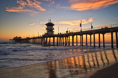Sunset at Surf City USA (Roving Vagabond) Tags: sunset huntington beach california socal ca sea seashore pier water ocean waves clouds color reflection landscape seascape seaside surf city usa
