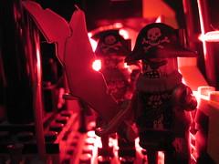 Zombie_Pirate_Attack (rd025) Tags: macromondays lego pirate zombie ship backlit macromonday red light macro