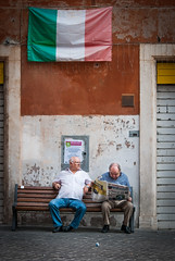 Italian relax (luca.onnis) Tags: street italy bench photography newspaper flag rest oldmen lucaonnis