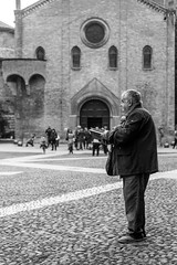 Reading while standing (studiorost) Tags: old bw italy white man black church stone reading book pavement churches seven bologna