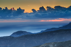Ethereal mountain sunset at twilight (envylight) Tags: lighting blue sunset sky orange cloud sun mountains nature weather silhouette sunrise landscape dawn twilight colorful glow peace dusk background scenic tranquility atmosphere formation cumulus ethereal environment peaks celestial mountainrange