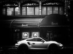 Harrod's Department Store, Brompton Road Knightsbridge (Simon & His Camera) Tags: city urban blackandwhite bw white mist black building london window monochrome car contrast dark iconic vignette simonandhiscamera
