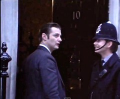 Circa Mid 1970's. Metropolitan Police Constable Attached To Cannon Row Police Station (Alpha Delta) On The Steps Of No 10 Downing Street. (sgterniebilko) Tags: uk london westminster ad security whitehall themall sw1 royals downingstreet centrallondon scotlandyard no10 metropolitanpolice alphadelta policeconstable inuniform canonrow cannonrowpolicestation aorwhitehalldivision