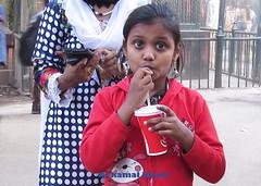 Eyes (A Kamal Khan) Tags: street travel red portrait india girl canon children kid asia child dress drink coke sx50 abkamalkhan akamalkhan