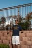 365x4.025: low winter sun (malik ml williams) Tags: sunlight selfportrait wall fence nikon speedlight strobe mixedlight sb800 365days pocketwizard strobist 365x4