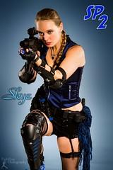 SP2: Skye (2) (FightGuy Photography) Tags: garter beautiful necklace gun scope rifle armor blonde fishnets m4 jessi braid actionhero studioa studiophotography womenwithweapons stuntwoman dangerousbeauty suckerpunched fightguyphotography