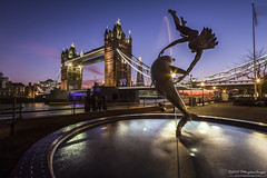Girl with a Dolphin by Tower Bridge (Tris1972 (tmorphewimages.co.uk)) Tags: city uk longexposure england sculpture london tower water fountain thames clouds canon river lights evening unitedkingdom wideangle le 7d riverthames toweroflondon uwa stkatherinesdocks ultrawideangle canon1022 davidwynne girlwithadolphin