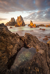 Camel Rock Dawn (laurie.g.w) Tags: ocean new light sky cloud seascape water pool rock wales sunrise dawn coast south shoreline rocky first tokina camel rmc sapphire headland bermagui 17mm