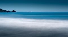Cerulean Sea - Long Exposure (byron bauer) Tags: byronbauer bigsur timeexposure beach sea ocean blue water foam black rocks sky serene calm smooth painterly minimal seascape horrizon