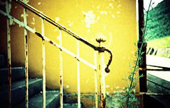 Hold on to me. (UrbaceousSentiment) Tags: italien italy film yellow analog lomo lca xpro crossprocessed italia slide gelb handrail analogue pushed vignetting mori diafilm gelnder handlauf vignettierung stabilimentoalluminio