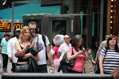 Faces of New York: Selfie stick couple (Canadian Pacific) Tags: usa us unitedstates ofamerica america american city urban newyork manhattan people newyorker timessquare aimg6730 selfie stick couple man woman lady guy