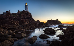 La Corbiere, No. 5. (Tim_Horsfall) Tags: ocean uk sunset sea sky lighthouse seascape beach water canon landscape eos is rocks long exposure slow dusk shore shutter jersey usm 6d corbiere f4l ef1635mm
