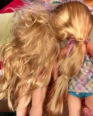 BEFORE: Thrift store Animator Rapunzel mess.  Comparison with my new girl. Hair full of elastics and brushed into mats. Parents, please remove the elastics before the poor kid tries to brush their dolly's hair. (Painters Life) Tags: messyhair beforepicture animatordoll disneyanimatorrapunzel disneyanimator disney