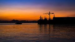 Rio, Sunrise (AdrianoSetimo) Tags: sea brazil seascape silhouette riodejaneiro sunrise landscape harbor boat barco s porto alvorada seaport goldenhour navio nascerdosol canonfd canonfd28mm museudoamanh panasonicgx7 olympicgamesofriodejaneiro