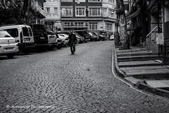 Street 159 (`ARroWCoLT) Tags: street sokak adam walking down arrowcolt samsung nx nxm midage man car parking sidewalk people bazaar pazar istanbul streetphotography emberlita market outdoor monochrome blackwhite siyahbeyaz nx300 eminn kadrga fatih