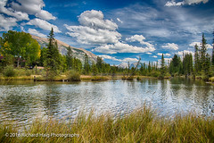A beautiful afternoon in Canmore ! (RichHaig) Tags: trees lake landscape nikonafsnikkor2412014ged fence gitzotripod alberta mountains sky canada richhaig water nikond800 clouds canmore cans2s banffnationalpark