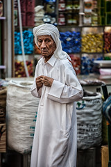 old man at the souk (azahar photography) Tags: manama bahrain male man bald balding adult portrait senior arab manly thinking white wisdom background masculinity beard black closeup middle eastern expression face father grandfather gray grey hair hippie hispanic human intellectual long look mustache old one people person professor retirement sad sadness shaggy skin meditation mourning grief