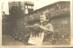 Just like his father (912greens) Tags: boys kids children readers 1930s backyards walls newspapers reading smiles smiling folksidontknow yards gardens favorites
