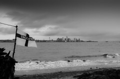 Liverpool, England (Mart_in_MCR) Tags: uk sea england sky urban blackandwhite black beach skyline liverpool river landscape coast waves cityscape britain flag cities estuary pearl mersey newbrighton merseyside rivermersey