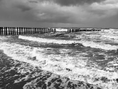 Stormy North Sea, No 2, Ameland 2007 (only black and white) Tags: bw storm clouds strand blackwhite high waves tide herbst northsea monochrom nordsee groynes sturm flut