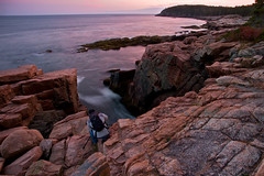 It's A Big World After All (SunnyDazzled) Tags: ocean travel sunset portrait man reflection evening nationalpark scenery waves photographer tripod maine cliffs shore backpack slowshutter granite geology acadia