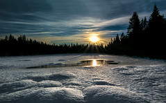 Winter (Explored) (Tore Thiis Fjeld) Tags: trees winter light sunset sky sun snow cold color reflection ice silhouette oslo norway clouds forest evening samsung sunrays spruce nordmarka coldwinter tarns nx210