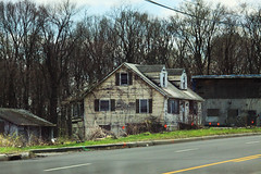 Little Old Farm House (lefeber) Tags: road door wood trees windows roof house newyork abandoned architecture farmhouse rural town vines woods village decay garage shed porch worn shutters peelingpaint gables smalltown hudsonvalley newwindsor