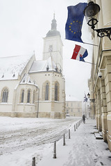 St. Marks' church in Zagreb, Croatia, during a snowstorm. (Astrobobo) Tags: travel winter white holiday snow storm tree tourism church beautiful architecture buildings square town europe european flag country sightseeing central snowstorm tracks croatia zagreb destination lantern balkans europeanunion stmarks
