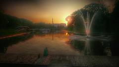 Evening... (Laulik) Tags: evening sunset water bridge fountain pier summer sky sun trees