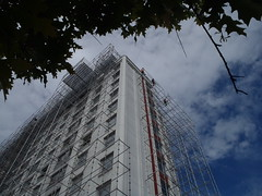 Hello up there (Eva the Weaver) Tags: sky blue building construction scaffold workers