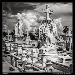La ltima morada (meggiecaminos) Tags: bw white black blanco graveyard angel clouds nuvole cross cementerio negro cuba bn graves cruz nubes tumbas bianco nero santiagodecuba croce cimiterio monumentosfunerarios